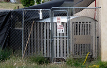 The kennel to a drug-sniffing police dog Nikka of Vaughn, N.M.  is shown in backyard of former Vaughn Police Chief Ernest