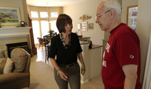 Pat Sneller, right, talks to her husband Lee Sneller as they prepare to leave for  an appointment in Flower Mound, Texas. A large study from Canada found that when doctors warn patients, and driving authorities, that they may be medically unfit to be on the road, there's a drop in serious crash injuries among those drivers. (AP Photo/LM Otero)