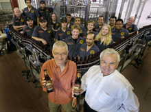 Steve Griffin  |  The Salt Lake Tribune Squatters founder Peter Cole, left, and Wasatch Beers founder Greg Schirf merged their microbrewery operations in 2000 and opened a new bottling line in 2010.