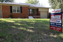 In this Friday, Sept. 21, 2012, photo,a home is for sale in Oklahoma City. Average U.S. rates on fixed mortgages fell again to new record lows. The decline suggests the Federal Reserve's stimulus efforts may be having an impact on mortgage rates. Mortgage buyer Freddie Mac said Thursday, Sept. 27, 2012, the rate on the 30-year loan dropped to 3.40 percent. That's down from last week's rate of 3.49 percent, which was the lowest since long-term mortgages began in the 1950s. (AP Photo/Sue Ogrocki)