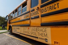 Trent Nelson  |  The Salt Lake Tribune Advertisements on school buses at Sunset Ridge Middle School in West Jordan, Utah, Friday, September 21, 2012.