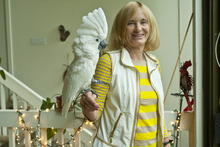 Chris Detrick  |  The Salt Lake Tribune University of Utah professor of anthropology Polly Wiessner poses for a portrait with her cockatoo at her home Tuesday September 25, 2012.
