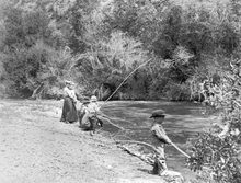 Young boy and his family fishing. Courtesy of Utah Historical Society