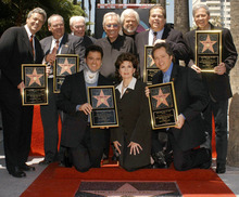 The Osmond family receive their star on the Walk of Fame in the Hollywood section of Los Angeles, Thursday, Aug. 7, 2003. Kneeling in front row from left are Donny, Marie, and the youngest member of the family, Jimmy. Standing back row from left are Jay, Tom, their dad, George, singer Andy Williams, Merrill, Alan, and Wayne. The single star honors siblings Alan, Wayne, Merrill, Jay, Donny, Marie, and Jimmy for their decades of work in entertainment. Donny wears a neck brace due to an injury he sufferedbody surfing in Hawaii. (AP Photo/Hollywood Chamber of Commerce, Bob Freeman)