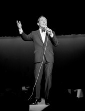 In this Aug. 5, 1966 photo provided by the Las Vegas News Bureau, Andy Williams performs at Caesars Palace in Las Vegas.  Andy Williams, whose hit recording