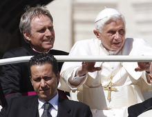 FILE - In this file photo taken Wednesday, May 2, 2012, Pope Benedict XVI arrives in St. Peter's square at the Vatican for a general audience as his then-butler Paolo Gabriele, bottom, and his personal secretary Georg Gaenswein sit in the car with him. Pope Benedict XVI's ex-butler Paolo Gabriele and another Vatican lay employee, Claudio Sciarpelletti, are scheduled to go on trial Saturday, Sept. 29, 2012, in the embarrassing theft of papal documents that exposed alleged corruption at the Holy See's highest levels. Gabriele was arrested May 24 after Vatican police found what prosecutors called an