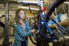 Paul Fraughton | Salt Lake Tribune Katie Johnson uses a wrench to remove the bottom bracket of a bike  so she and her team can repack it  with grease.   Thursday, September 27, 2012