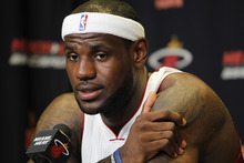 Miami Heat basketball player LeBron James speaks during the team's NBA media day in Miami, Friday, Sept. 28, 2012. (AP Photo/Marta Lavandier)