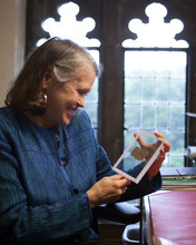 In this Sept. 5, 2012 photo released by Harvard University, divinity professor Karen L. King holds a fourth century fragment of papyrus that she says is the only existing ancient text that quotes Jesus explicitly referring to having a wife. King, an expert in the history of Christianity, says the text contains a dialogue in which Jesus refers to