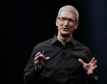 In this Wednesday, Sept. 12, 2012 photo, Apple CEO Tim Cook speaks during an introduction of the new iPhone 5 in San Francisco. Cook says the company is