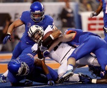 BYU running back Michaeel Alisa is stopped near the goal line by the Boise State defense in the first half Thursday Sept. 20, 2012 at Bronco Stadium in Boise.