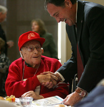 Steve Griffin  |  The Salt Lake Tribune Decked out in his Ute gear, 102-year-old Otis Curtis, of South Jordan, chats with Gov. Gary R. Herbert during the 26th Annual Centenarians Day Celebration at Noah's Reception Center in South Jordan, Friday September 28, 2012.
