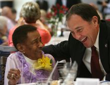 Steve Griffin  |  The Salt Lake Tribune 102-year-old Velma Saunders laughs with Gov. Gary R. Herbert Friday after telling him she was voting for him during the 26th Annual Centenarians Day Celebration at Noah's Reception Center in South Jordan.