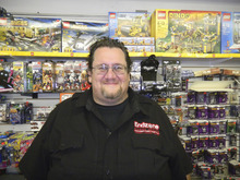 Tom Wharton | The Salt Lake Tribune Endzone Hobby Center owner John Irsik carries hundreds of games, collectables and comic books at his Clearfield store.