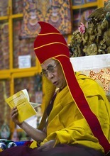 Tibetan spiritual leader the Dalai Lama wearing a red ceremonial hat participates in a prayer ceremony organized for his long life at the Tsuglakhang temple in Dharmsala, India, Friday, Sept. 28, 2012. More than 400 delegates are in Dharmsala to attend the four-day Special General Meeting ending Friday to discuss their strategy in response to the self-immolations in Tibet in protest against Chinese rule. (AP Photo/Ashwini Bhatia)