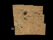 This image provided by NASA shows shows a Martian rock outcrop near the landing site of the rover Curiosity thought to be the site of an ancient streambed. Curiosity landed in a crater near Mars' equator on Aug. 5 on a two-year mission to study whether the environment could have been favorable for microbial life. (AP Photo/NASA)