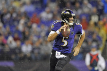 Baltimore Ravens quarterback Joe Flacco carries the ball into the end zone for a touchdown during the second half of an NFL football game against the Cleveland Browns in Baltimore, Thursday, Sept. 27, 2012. (AP Photo/Gail Burton)