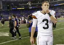 Cleveland Browns quarterback Brandon Weeden walks off the field after their 23-16 loss to the Baltimore Ravens in Baltimore, Thursday, Sept. 27, 2012. (AP Photo/Patrick Semansky)