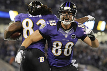 Baltimore Ravens wide receiver Torrey Smith (82) celebrates his touchdown with tight end Dennis Pitta (88) during the first half of an NFL football game against the Cleveland Browns in Baltimore, Thursday, Sept. 27, 2012. (AP Photo/Gail Burton)