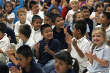 Francisco Kjolseth  |  The Salt Lake Tribune Kids cheer on their teachers as 20 of them at Salt Lake City's Riley Elementary School got a boost on Thursday, September 27, 2012, when they are presented gift cards from Sam's Club to help them finance classroom supplies. Riley Elementary is a low-income, high minority school that struggles with a student population where 90 percent have free and reduced lunch and more than half are non-native English speaking students. A school assembly was organized to celebrate the donation. As every Sam's club across the country picked a school in their area to present a similar donation.