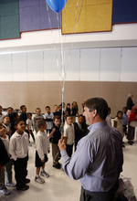 Francisco Kjolseth  |  The Salt Lake Tribune Riley Elementary principal Randy Miller gets numerous requests for his balloons from students following a special presentation on Thursday, September 27, 2012. Twenty teachers at Salt Lake City's Riley Elementary School got a boost when they are presented gift cards from Sam's Club to help them finance classroom supplies. Riley Elementary is a low-income, high minority school that struggles with a student population where 90 percent have free and reduced lunch and more than half are non-native English speaking students. A school assembly was organized to celebrate the donation. As every Sam's club across the country picked a school in their area to present a similar donation.