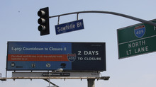 A countdown clock running on a digital billboard on Santa Monica Boulevard in West Los Angeles reminds motorists Wednesday, Sept. 26, 2012, that they need to prepare and plan for the two-day closure of the Interstate 405 freeway over the Sepulveda Pass this coming weekend, Sept. 29-30. The Los Angeles County Metropolitan Transportation Authority (Metro) and Clear Channel Outdoor have partnered on the campaign to encourage commuters and residents to stay off the roads or plan ahead during the event known as Carmageddon II. (AP Photo/Reed Saxon)