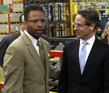 FILE - In this April 4, 2012 file photo, Treasury Secretary Timothy Geithner, right, and Rep Jesse Jackson Jr., D-Ill. tour the Ford Motor Company Stamping Plant in Chicago Heights, Ill. With the November election only five weeks away, Jackson's absence from work and the campaign trail is testing patience in Chicago. His GOP opponent is now criticizing him for it after pledging not to. Friendly editorial writers are now urging he come forward and finally explain himself. And Jackson's alderman wife, Sandi, is having to deny in public that she might step in to replace him. The Jackson camp says only that the congressman is still on the ballot and will only return to work when cleared for that by a doctor, but the uncertainty and mystery is feeding talk of what happens if he resigns and needs to be replaced, a process with a sordid history in Chicago and Illinois.  (AP Photo/Charles Rex Arbogast, File)