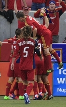 Members of Real Salt Lake celebrate Fabian Espindola goal in the first half of an MLS soccer game with the Portland Timbers Saturday, Sept. 22, 2012, in Sandy, Utah.  (AP Photo/Rick Bowmer)