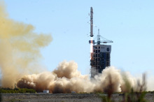 In this photo released by China's Xinhua News Agency, a rocket carrying Venezuelan satellite VRSS-1, a remote sensing satellite, lifts off at the Jiuquan Satellite Launch Center in Jiuquan, northwest China's Gansu Province, Saturday, Sept. 29, 2012. China launched the second satellite built for Venezuela's government. (AP Photo/Xinhua, Nie Jianjiang) NO SALES