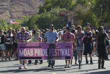 Courtesy of Lisa J. Church Participants in the Moab Pride Visibility March walk through downtown Moab on Saturday morning.