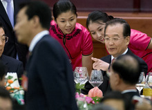 Chinese Premier Wen Jiabao, right, chats with hostesses during a dinner marking the 63rd anniversary of the founding of the People's Republic of China held at the Great Hall of the People in Beijing Saturday, Sept. 29, 2012. (AP Photo/Andy Wong)