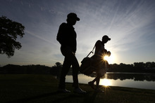 USA's Bubba Watson walks up the second hole during a foursomes match at the Ryder Cup PGA golf tournament Saturday, Sept. 29, 2012, at the Medinah Country Club in Medinah, Ill. (AP Photo/David J. Phillip)
