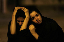 Bahraini women sit on the street and mourn a youth killed during an anti-government protest, allegedly by police shotgun fire, in the western village of Sadad, Bahrain, early Saturday, Sept. 29, 2012. An Interior Ministry statement said a police patrol was attacked with petrol bombs and iron rods, and one person died when
