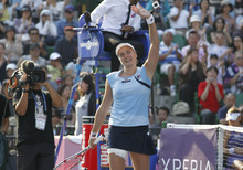 Nadia Petrova of Russia holds waves after defeating Agnieszka Radwanska of Poland 6-0, 1-6, 6-3 in their final match at the Japan Pan Pacific Open tennis tournament in Tokyo, Saturday, Sept. 29, 2012. (AP Photo/Koji Sasahara)
