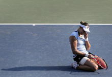 Nadia Petrova of Russia reacts after winning her final match against Agnieszka Radwanska of Poland at the Pan Pacific Open women's tennis tournament in Tokyo Saturday, Sept. 29, 2012. Petrova won the match 6-0, 1-6, 6-3. (AP Photo/Itsuo Inouye)