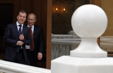 Russian President Vladimir Putin and Russian Prime Minister Dmitry Medvedev, left, at the Novo-Ogaryovo residence outside Moscow, Thursday, Sept. 27, 2012. (AP Photo/RIA-Novosti, Dmitry Astakhov, Government Press Service)