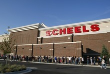 Chris Detrick     The Salt Lake Tribune Customers wait in line to get into Scheels Saturday September 29, 2012. Scheels opened its 220,000-square-foot mega-sporting goods store in Sandy. Featuring a 16-car Ferris wheel rising toward a skylight, a 16,000-gallon double-arched salt water aquarium, a boating department, game centers and a focus on fashionable apparel, the store is meant to be a fun destination, said Dan Hermanson, an assistant store leader.
