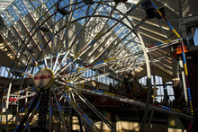 Chris Detrick     The Salt Lake Tribune The Ferris wheel at Scheels Saturday September 29, 2012. Scheels opened its 220,000-square-foot mega-sporting goods store in Sandy. Featuring a 16-car Ferris wheel rising toward a skylight, a 16,000-gallon double-arched salt water aquarium, a boating department, game centers and a focus on fashionable apparel, the store is meant to be a fun destination, said Dan Hermanson, an assistant store leader.