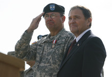 Scott Sommerdorf  |  The Salt Lake Tribune              Maj. Gen. Brian L. Tarbet salutes troops passing in review with Utah Governor Gary Herbert. After 12 years the adjutant general of the Utah National Guard, Maj. Gen. Brian L. Tarbet, relinquished command to Maj. Gen. Jefferson S. Burton at a ceremony on the field named for Tarbet, Saturday, September 29, 2012.