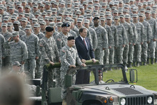 Scott Sommerdorf  |  The Salt Lake Tribune              Utah Gov. Gary Herbert, right, commander in chief of the Utah National Guard, reviewed his troops in a pass-and-review ceremony with  Gen. Michael Liechty, front left, Maj. Gen. Jefferson S. Burton, back left, and Maj. Gen. Brian L. Tarbet, Saturday, September 29, 2012.