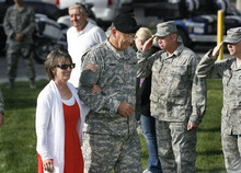 Scott Sommerdorf  |  The Salt Lake Tribune              Maj Gen. Brian L. Tarbet arrives with his wife, Mary. After 12 years as adjutant general of the Utah National Guard,  Tarbet relinquished command to Maj. Gen. Jefferson S. Burton at a ceremony on the field named for Tarbet, Saturday, September 29, 2012.