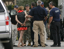 Scott Sommerdorf  |  The Salt Lake Tribune              David Charles Baker in custody wearing a dress after police arrested him at his home after a long standoff. Unified Police respond to a report of a man barricaded in his home with possible explosives at 3128 Del Mar in Millcreek, Sunday, September 23, 2012.