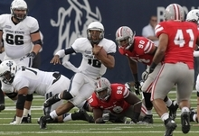 Utah State quarterback Chuckie Keeton (16) scrambles as UNLV linebacker Tani Maka (41) looks on in the first quarter of an NCAA college football game Saturday, Sept. 29, 2012, in Logan, Utah.  (AP Photo/Rick Bowmer)