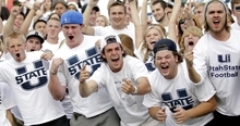 Utah State fans show their support before the start of an  NCAA college football game with UNLV Saturday, Sept. 29, 2012, in Logan, Utah.  (AP Photo/Rick Bowmer)