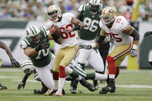 San Francisco 49ers wide receiver Mario Manningham (82) breaks a tackle by New York Jets defensive end Mike DeVito (70) during the first half of an NFL football game Sunday, Sept. 30, 2012, in East Rutherford, N.J. (AP Photo/Kathy Willens)