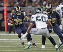 St. Louis Rams  Steven Jackson runs against Seattle Seahawks outside linebacker K.J. Wright (50) fduring the first half of an NFL football game Sunday, Sept. 30, 2012, in St. Louis. (AP Photo/Tom Gannam)