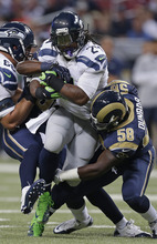 Seattle Seahawks running back Marshawn Lynch (24) is tackled by St. Louis Rams outside linebacker Jo-Lonn Dunbar (58) during the first half of an NFL football game Sunday, Sept. 30, 2012, in St. Louis. (AP Photo/Darron Cummings)
