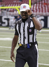 Referee Mike Carey tips his cap to the fans as he walks onto the field before an NFL football game  between the St. Louis Rams and Seattle Seahawks Sunday, Sept. 30, 2012, in St. Louis. (AP Photo/Tom Gannam)