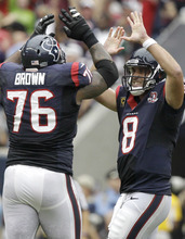 Houston Texans quarterback Matt Schaub (8) and  Duane Brown (76) celebrate a touchdown against the Tennessee Titans during the third quarter of an NFL football game between the Houston Texans and the Tennessee Titans Sunday, Sept. 30, 2012, in Houston. (AP Photo/Patric Schneider)
