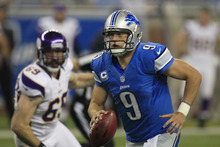 Detroit Lions quarterback Matthew Stafford (9) scrambles away from Minnesota Vikings defensive end Jared Allen (69) during the first quarter of an NFL football game at Ford Field in Detroit, Sunday, Sept. 30, 2012. (AP Photo/Carlos Osorio)